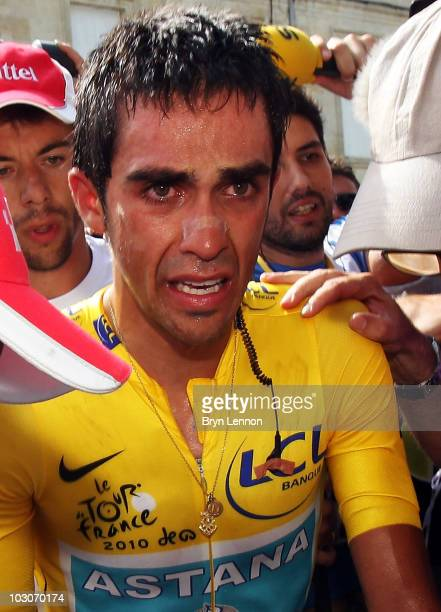 Alberto Contador of Spain and the Astana Team makes his way to the podium after stage nineteen a 52km individual time trial from Bordeaux to Pauillac...