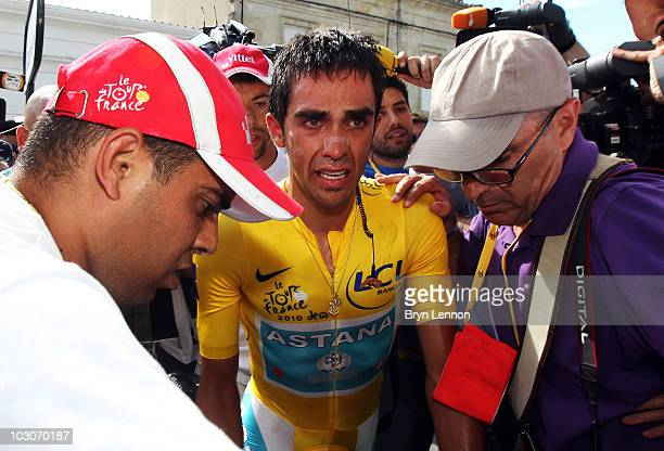 Alberto Contador of Spain and the Astana Team makes his way to the podium after stage nineteen, a 52km individual time trial from Bordeaux to...