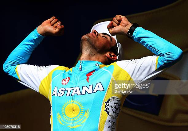 Alberto Contador of Spain and the Astana Team reacts on the podium after retaining his yellow jersey on stage nineteen, a 52km individual time trial...