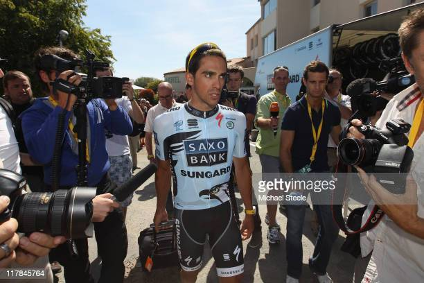 Alberto Contador of Spain and the Saxo Bank Sungard team leaves his hotel ahead of training on July 1 2011 in Les Herbiers France