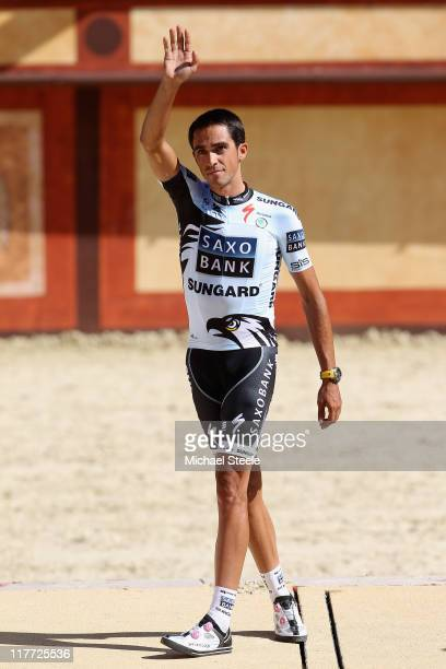 Alberto Contador of Spain and the Saxobank Sungard team waves to the crowd during the official team presentations at Puy du Fou on June 30 2011 in...