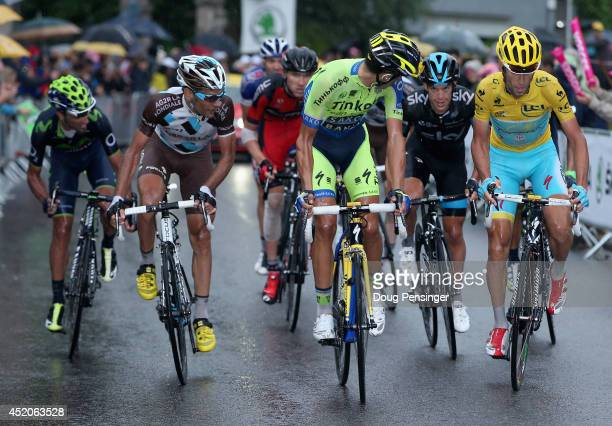 Alberto Contador of Spain and Tinkoff-Saxo attacks the group of the yellow jersey of Vincenzo Nibali of Italy and the Astana Pro Team on the final...