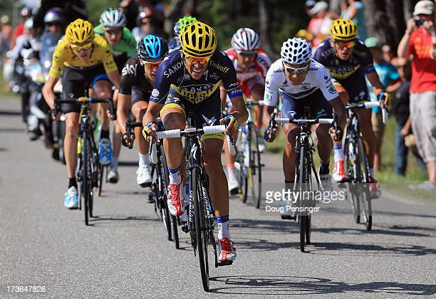 Alberto Contador of Spain riding for Team Saxo-Tinkoff attacks the group of the yellow jersey of Chris Froome of Great Britain riding for Sky...