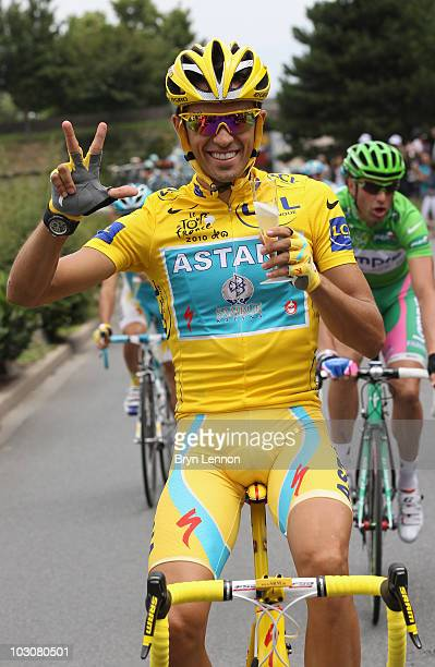 Alberto Contador of team Astana celebrates his third victory during the twentieth and final stage of Le Tour de France 2010 from Longjumeau to the...