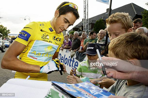 Alberto Contador signs autographs as he is greeted by fans before the 30th edition of the prof criterium at the ''Ronde van Stiphout' on July 28 2009...
