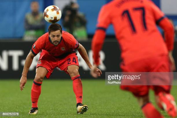 Alberto de la Bella of FC Real Sociedad vie for the ball during the UEFA Europa League Group L football match between FC Zenit Saint Petersburg and...