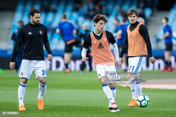 Alberto de la Bella of Real Sociedad Alvaro Odriozola Arzallus of Real Sociedad and Jon Bautista of Real Sociedad during the match between Real...