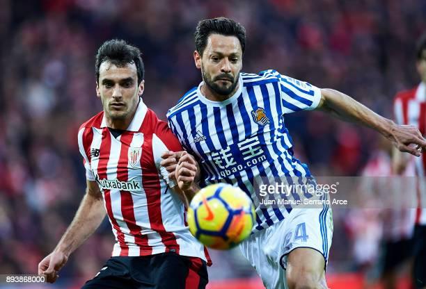 Alberto de la Bella of Real Sociedad competes for the ball with Inigo Lekue of Athletic Club during the La Liga match between Athletic Club Bilbao...