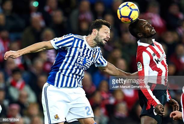 Alberto de la Bella of Real Sociedad competes for the ball with 'nInaki Williams of Athletic Club during the La Liga match between Athletic Club...