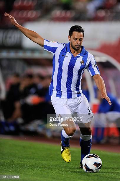 Alberto de la Bella of Real Sociedad de Futbol runs with the ball during the La Liga match between RCD Mallorca and Real Sociedad de Futbol at...