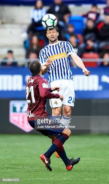 Alberto de la Bella of Real Sociedad duels for the ball with Pedro Leon of SD Eibar during the La Liga match between SD Eibar and Real Sociedad de...