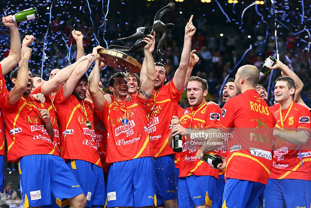 Alberto Entrerrios of Spain lifts the cup on the podium after winning the Men's Handball World Championship 2013 final match between Spain and Denmark at Palau Sant Jordi on January 27, 2013 in Barcelona, Spain.