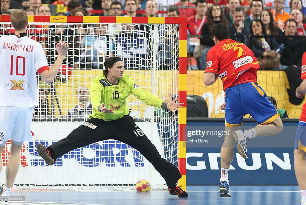 Alberto Entrerr'os of Spain scores a goal to Jannick Green, goalkeeper of Denmark during the Men's Handball World Championship 2013 final match between Spain and Denmark at Palau Sant Jordi on January 27, 2013 in Barcelona, Spain.