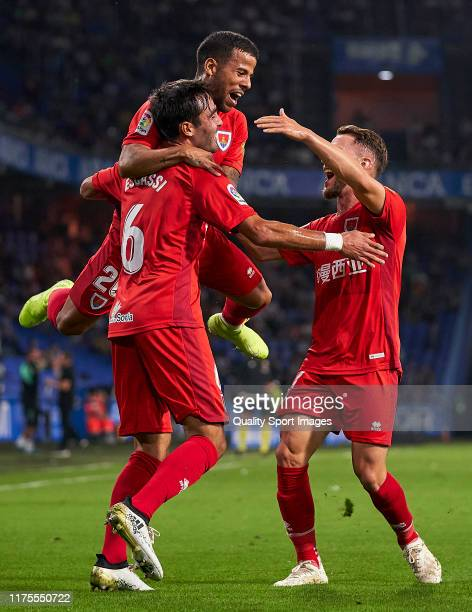 Alberto Escassi of CD Numancia celebrates with his team mates after scoring his team's first goal during the La Liga Smartbank match between...