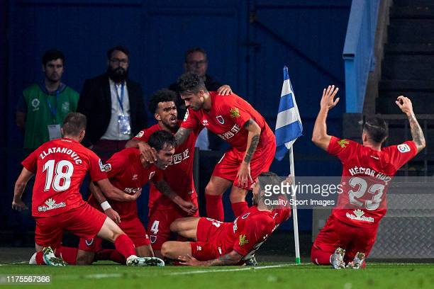 Alberto Escassi of CD Numancia celebrates with his team mates after scoring his team's third goal during the La Liga Smartbank match between...