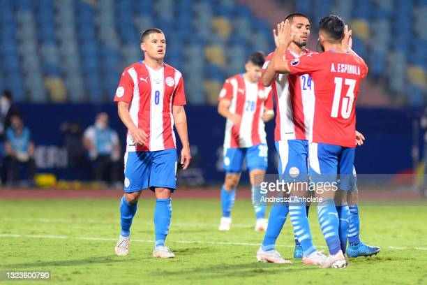 Alberto Espinola of Paraguay celebrates with teammate Hector Martinez after winning a Group A match between Paraguay and Bolivia at Estádio Olímpico...