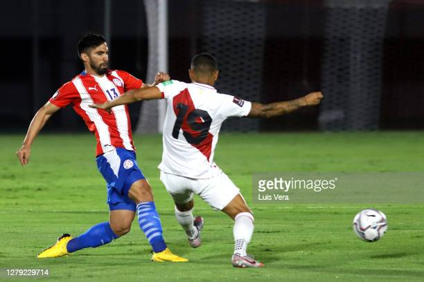 Alberto Espinola of Paraguay competes for the ball with Luis Advincula of Peru during a match between Paraguay and Peru as part of South American...