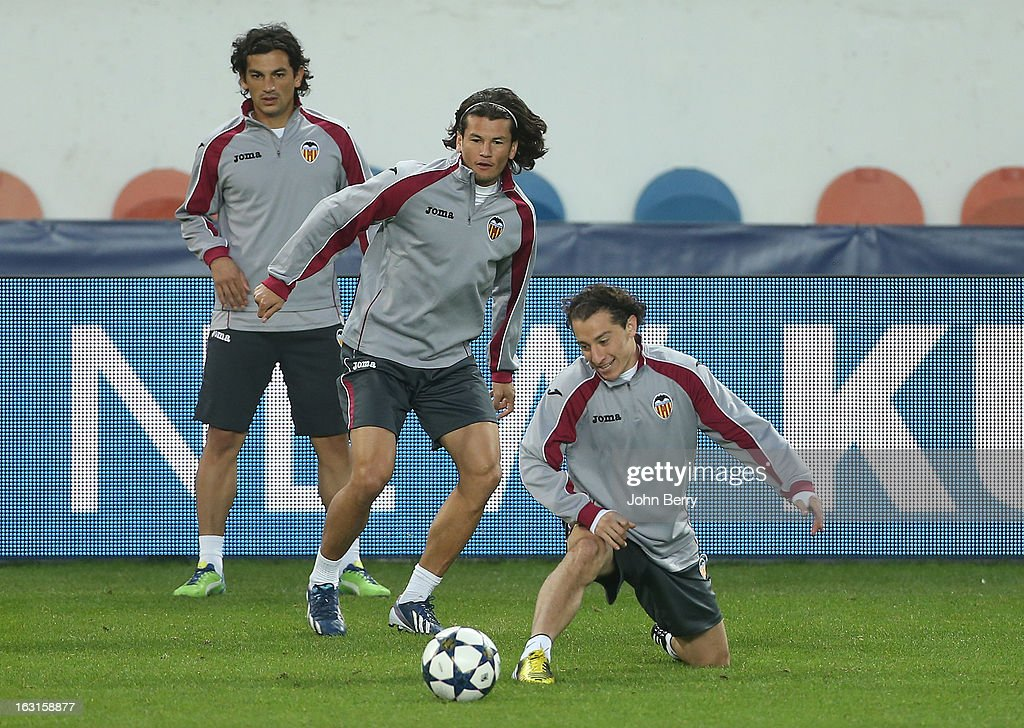 Alberto Facundo Costa, Nelson Valdez and Andres Guardado of Valencia warm up during the training session on the eve of the Champions League match between Paris Saint Germain FC and Valencia CF at the Parc des Princes stadium on March 5, 2013 in Paris, France.