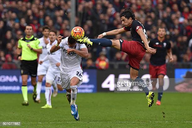 Alberto Facundo Costa of Genoa CFC in action against Anthony Mounier of Bologna FC during the Serie A match betweeen Genoa CFC v Bologna FC at Stadio...