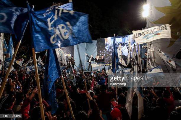 Alberto Fernandez presidential candidate for the Frente de Todos party left gestures as he speaks during a primary election night rally in the...