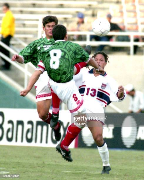 Alberto Garcia Aspe of Mexico and Cobi Jones of the United States during the match between Mexico and United States in Foxboro Massachusetts on April...