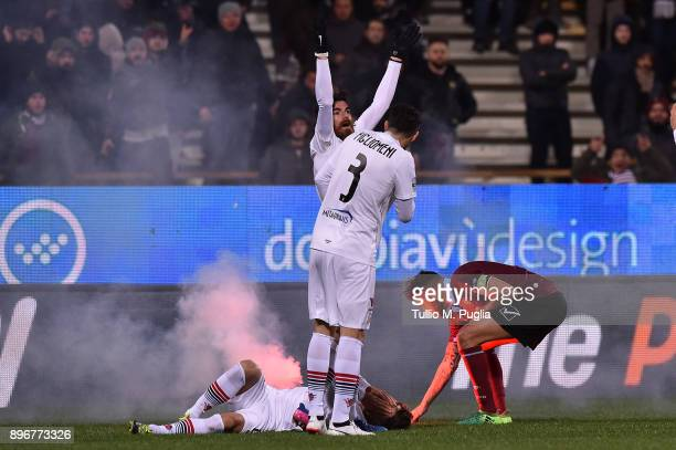 Alberto Gerbo of Foggia lies on the pitch after hitting by a flare as he was celebrated his team's second goal during the Serie B match between US...