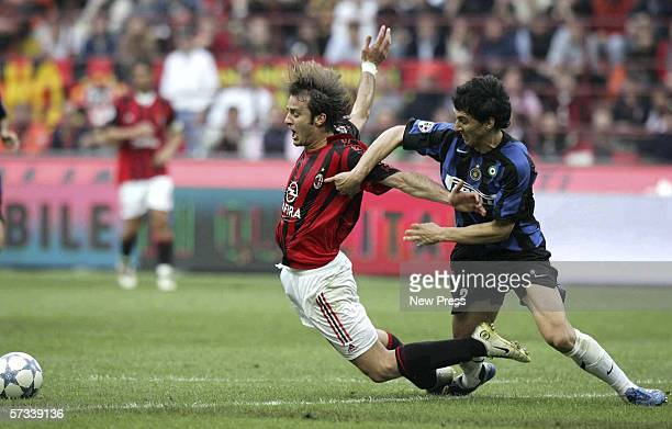 Alberto Gilardino of AC Milan goes down after a challenge from Nicolas Burdisso of Inter during the Serie A match between AC Milan and Inter Milan at...