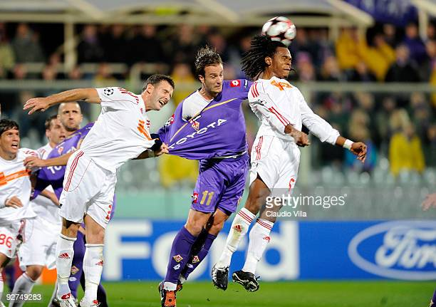 Alberto Gilardino of ACF Fiorentina competes for the ball with Zoltan Szelesi and Luis Ramos of VSC Debrecen during the UEFA Champions League Group E...
