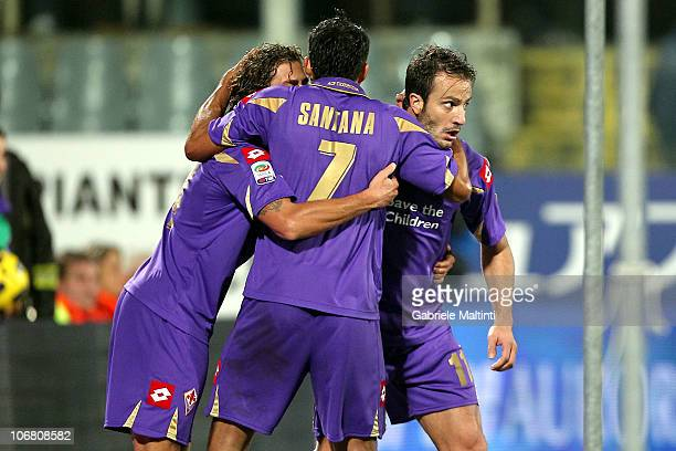 Alberto Gilardino of ACF Fiorentina is congratulated by teammate Mario Santana after scoring the opening goal during the Serie A match between ACF...