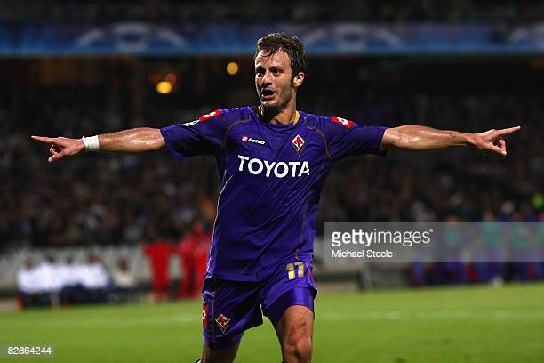 Alberto Gilardino of Fiorentina celebrates scoring the second goal during the UEFA Champions League Group F match between Lyon and Fiorentina at the...