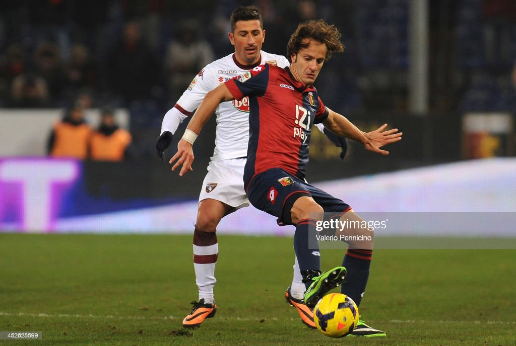 Alberto Gilardino (R) of Genoa CFC is challenged by Giuseppe Vives of Torino FC during the Serie A match between Genoa CFC and Torino FC at Stadio Luigi Ferraris on November 30, 2013 in Genoa, Italy.