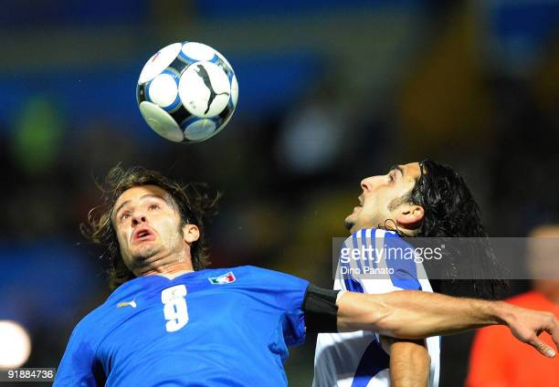 Alberto Gilardino of Italy battles for the ball on air with players of Cyprus during the FIFA2010 World Cup Group 8 Qualifier match between Italy and...