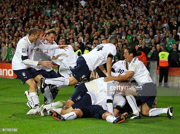 Alberto Gilardino of Italy gets jumped on by fellow team mates after scoring during the FIFA 2010 World Cup European Qualifying match between the...