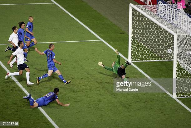 Alberto Gilardino of Italy heads the ball past Goalkeeper Kasey Keller of the USA to score the opening goal during the FIFA World Cup Germany 2006...