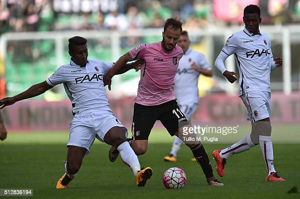 Alberto Gilardino of Palermo and Amadou Diawara of Bologna compete for the ball during the Serie A match between US Citta di Palermo and Bologna FC...