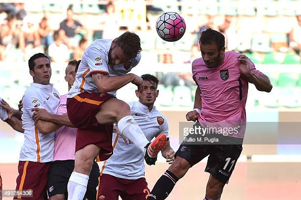 Alberto Gilardino of Palermo and Daniele De Rossi of Roma compete for the ball during the Serie A match between US Citta di Palermo and AS Roma at...