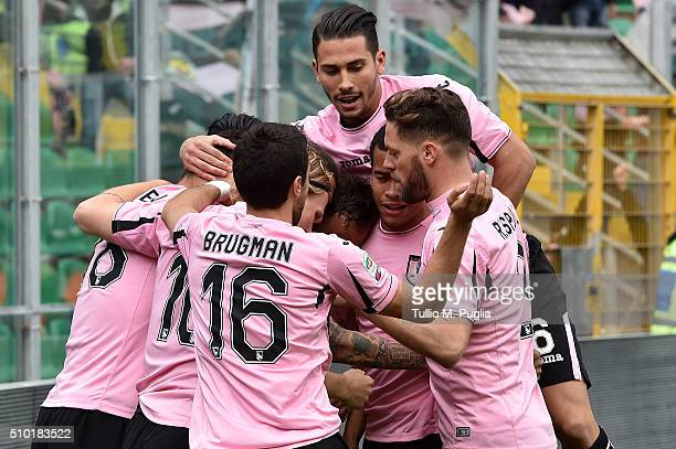 Alberto Gilardino of Palermo celebrates with team mates after scoring the opening goal during the Serie A match between US Citta di Palermo and...
