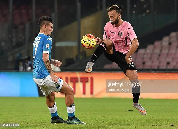 Alberto Gilardino of Palermo is challenged by Marek Hamsik of Napoli during the Serie A match between SSC Napoli and US Citta di Palermo at Stadio...