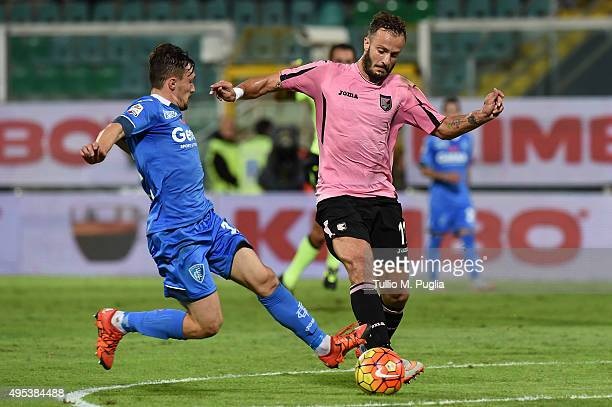 Alberto Gilardino of Palermo is challenged by Silva Mario Rui of Empoli compete for the ball during the Serie A match between US Citta di Palermo and...