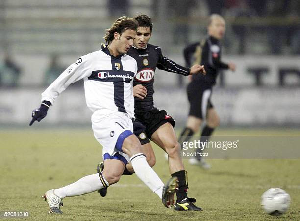 Alberto Gilardino of Parma and Michele Pazienza of Udinese in action during thwe Serie A match between Parma and Udinese at the Stadio Ennio Tardini...
