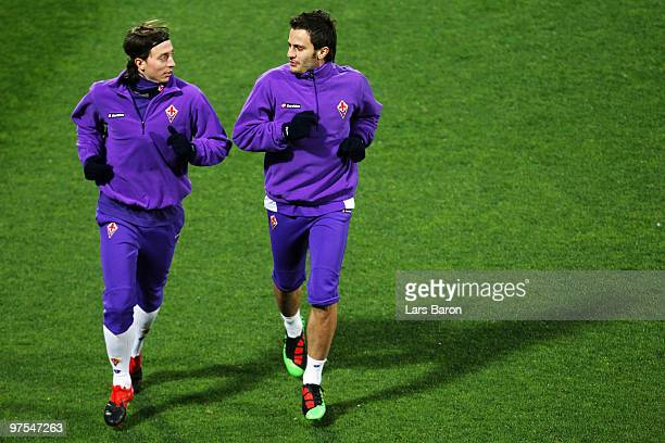 Alberto Gilardino warms up with team mate Riccardo Montolivo during a AFC Fiorentina training session at Artemio Franchi Stadium on March 8 2010 in...