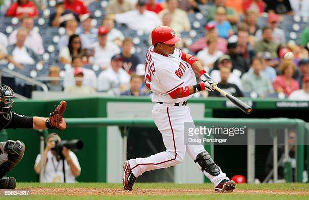 Alberto Gonzalez of the Washington Nationals hits a two run RBI against the Florida Marlins during their MLB game on August 6 2009 at Nationals Park...