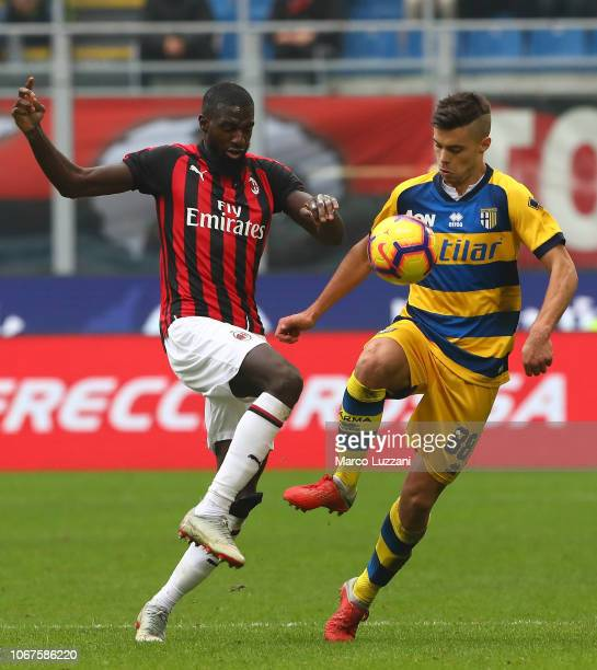 Alberto Grassi of Parma Calcio of Parma Calcio competes for the ball with Tiemoue Bakayoko of AC Milan during the Serie A match between AC Milan and...