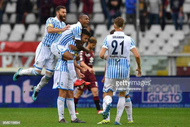 Alberto Grassi of Spal celebrates the opening goal with teammates during the Serie A match between Torino FC and Spal at Stadio Olimpico di Torino on...