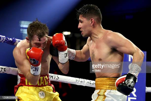 Alberto Guevara punches Isaac Lowe during their featherweight bout on February 22 2020 at MGM Grand Garden Arena in Las Vegas Nevada