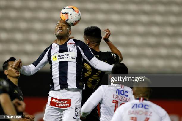 Alberto Junior Rodríguez Valdelomar of Alianza Lima heads the ball during a Group F match between Alianza Lima and Racing Club as part of Copa...