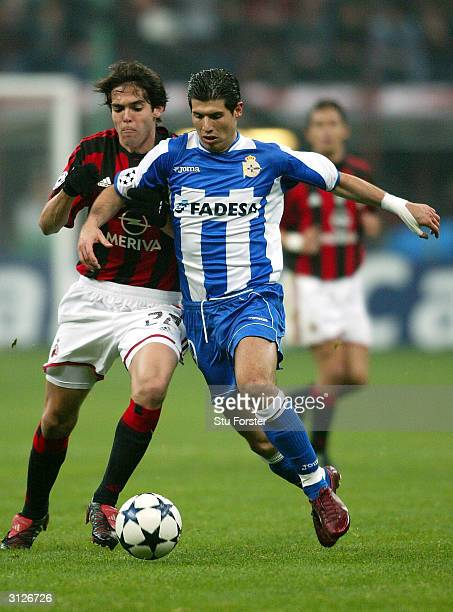 Alberto Luque of Deportivo pulls away from AC Milan midfielder Kaka during the UEFA Champions League Quarter Final match between AC Milan and...