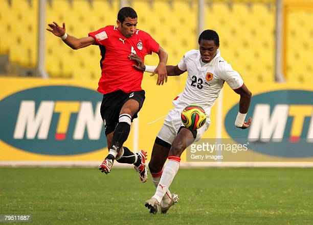 Alberto Manucho of Angola competes with Shady Mohamed of Egypt during the AFCON Quarter final match between Egypt and Angola held at the Baba Yara...
