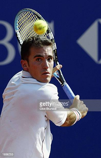 Alberto Martin of Spain plays a backhand against Fernando Vicenete of Spain during the third round of the Tennis Masters at The Monte Carlo Country...