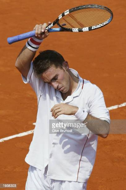Alberto Martin of Spain shows his dejection during his straight sets defeat by Juan Carlos Ferrero of Spain during the quarterfinal of the Tennis...